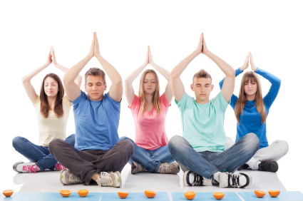Group of teenagers meditating.